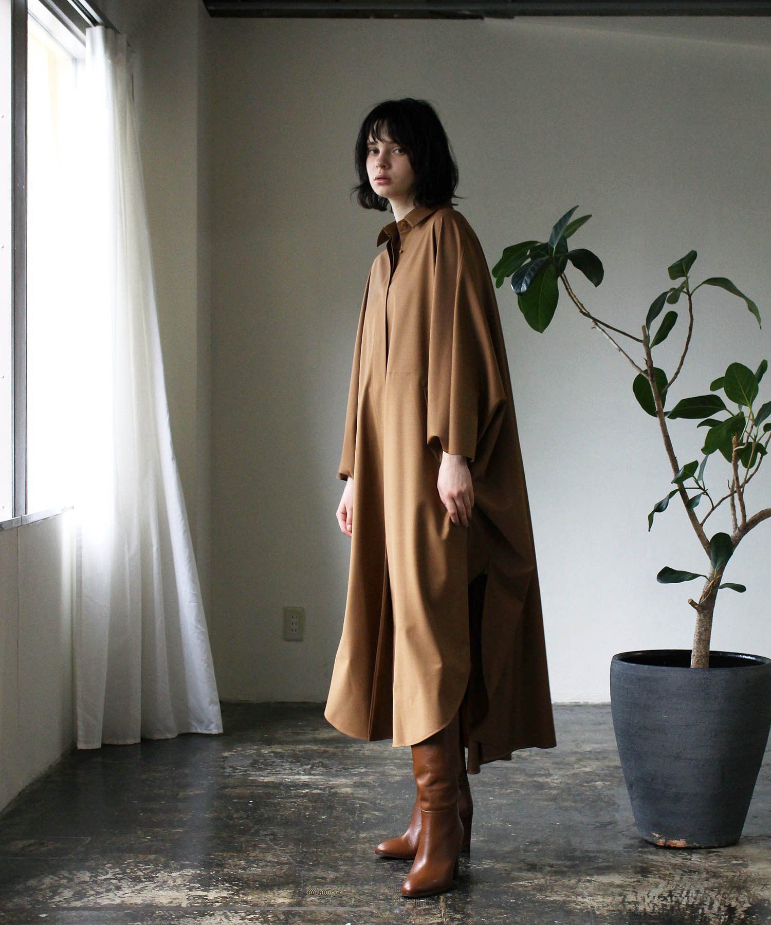 <STUMBLY>big silhouette poncho
